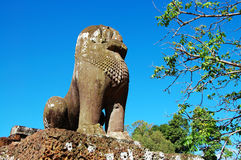 Guardian lion over blue sky Royalty Free Stock Photo