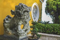 The guardian lion sculpture at Mount Putuo royalty free stock image
