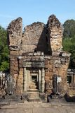 Guardian lion statues looking toward gate tower at the 10th Century East Mebon temple. Scene around the Angkor Archaeological Park. The site contains the remains Stock Photography