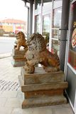 Guardian lions or Fo-dogs flank the entrance gates Buddhist temple. The guard lion or stone lion chin 石狮 Shíshī is a popular animal royalty free stock images