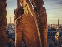 The Guardian. An old gargoyle takes care and have a look of the Paris city landscape stock photography