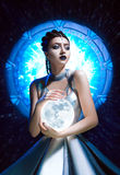 Guardian of portals. Queen of the cosmic spaces , fighting lady from the future , a fantastic image , fashionable tonin stock photo