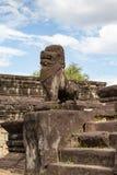 Guardian sculpture protecting the entrance to Bakong temple, Siem Reap, Cambodia, Asia royalty free stock photos