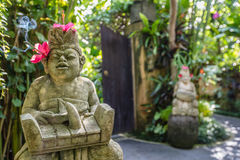 Guardian statue at the entrance with smoking incense, Bali Island, Indonesia. Guardian statue at the entrance with flowers and smoking incense, Bali Island Stock Image