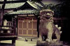Guardian in the temple. Japanese Shi Shi Guardian in the temple, cross-processed Royalty Free Stock Photo