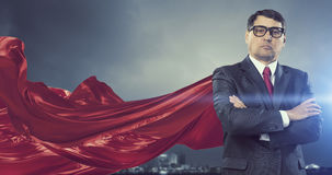 On guardiance of your interests . Mixed media. Aged businessman in red cape with arms crossed on chest. Mixed media Stock Photo