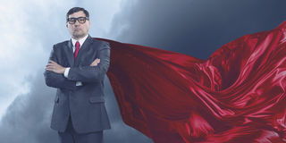 On guardiance of your interests . Mixed media. Senior businessman wearing cape with arms crossed on chest . Mixed media Royalty Free Stock Photography