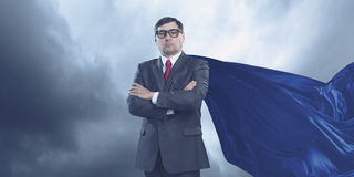 On guardiance of your interests . Mixed media. Senior businessman wearing cape with arms crossed on chest . Mixed media Royalty Free Stock Images
