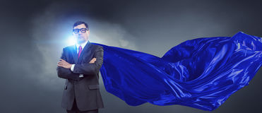 On guardiance of your interests . Mixed media. Senior businessman wearing cape with arms crossed on chest . Mixed media Royalty Free Stock Photo
