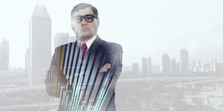 On guardiance of your interests. Senior businessman with arms crossed on chest against modern cityscape Royalty Free Stock Image