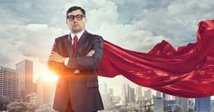 On guardiance of your interests. Senior businessman dressed as superhero against cityscape background Royalty Free Stock Photo