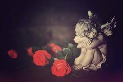 Guardiano e rose di angelo immagine stock