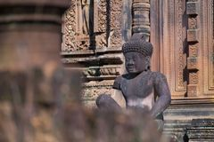 Guardians Carvings at Banteay Srei Red Sandstone Temple, Cambodia. Stock Photo