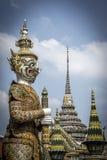 Guardians at the entrance to Temple of the Emerald Buddha. At Grand Royal Palace in Bangkok, Thailand Royalty Free Stock Photos