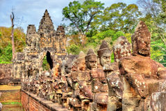 Guardians at the South Gate of Angkor Thom - Siem Reap, Cambodia Stock Photos