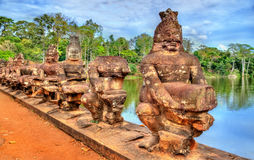 Guardians at the South Gate of Angkor Thom - Siem Reap, Cambodia Stock Image