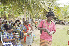 GUARDIANS OF TRADITIONS AND VALUES. Guardians of tradition among the peoples lagunaines Ivory Coast with colorful clothes making public démontrations to explain Stock Images