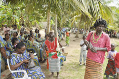 GUARDIANS OF TRADITIONS AND VALUES. Guardians of tradition among the peoples lagunaines Ivory Coast with colorful clothes making public démontrations to explain Royalty Free Stock Images