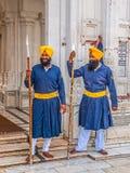 Guardie del Sikh al tempio dorato Fotografia Stock