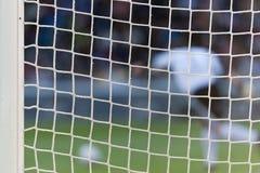 Guardien de but jouant au football Photographie stock libre de droits