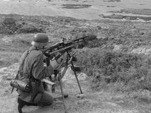 Guarding the Atlantic Wall. A WWII German Soldier (re-enactment) with machine gun guards his section of the Atlantic Wall - Corbiere Point, Jersey. Ammunition Royalty Free Stock Images