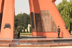 Guarding the eternal flame. An editorial colour image of two soldiers in ceremonial uniform and carrying a rifles in Moldova, Eastern Europe. You see them stock images
