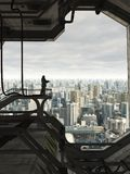 Guarding the Future City. Science fiction illustration of a lone Space Marine guard watching over the skyline of a future city, 3d digitally rendered Royalty Free Stock Images