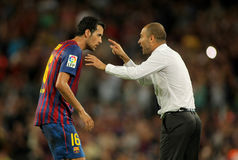 Guardiola of FC Barcelona give orders. Guardiola trainer of FC Barcelona gives orders to Sergio Busquets during a Spanish League match against CF Villarreal at Stock Image