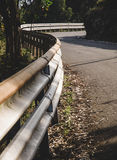 Guardrail and curve. In a road outdoors Stock Image