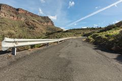 Guardrail on empty mountain road. As Gran Canaria landscape Royalty Free Stock Images