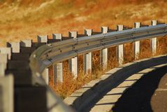 Guardrail in fall. Guardrail along road in fall Royalty Free Stock Photos