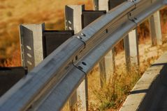 Guardrail in fall. Guardrail along road in fall Royalty Free Stock Images