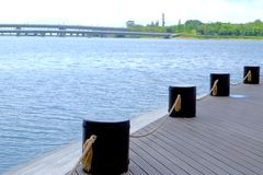 Guardrail pillars. Lakes, sea or river banks have guardrails, chains, and rope fences Stock Photo