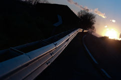 Guardrail Vanish On Road At Sunset Stock Image
