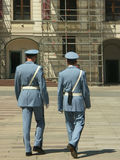 Guards. Two guards walking through yard royalty free stock photography