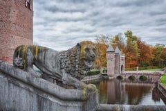 The guards of the castle. Kasteel de Haar in autumn, province of Utrecht, Netherlands Royalty Free Stock Images