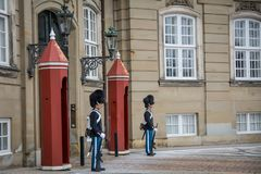 Guards in front of Amalienborg Castle. Denmark. stock photography