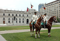 Guards on horses at palace Royalty Free Stock Photos