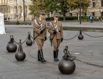 Guards marching in a circle around the flagpole near the Hungarian Parliament Building royalty free stock images