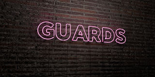 GUARDS -Realistic Neon Sign on Brick Wall background - 3D rendered royalty free stock image Stock Images