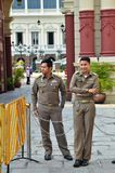 Guards stand in front of The Grand Palace in Bangkok, Thailand Stock Photos