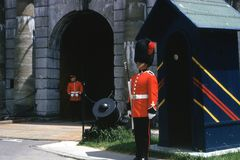 Guards at Tower of London. Two guards dressed in red guard the gate at the Tower of London Royalty Free Stock Photography