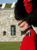 Guardsman with Citadel. A member of the Canadian Royal 22nd Regiment stands guard at the gates to the Citadel in Old Quebec City, Quebec, Canada royalty free stock photo