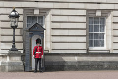 The Guardsmen at the Buckingham Palace in London Stock Photos