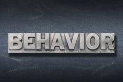 Guarida de la palabra del comportamiento imagenes de archivo
