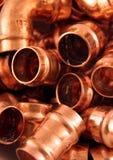 Guarniciones de cobre de los fontaneros Fotos de archivo