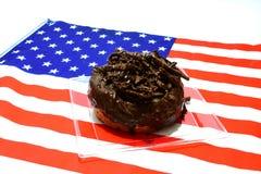 Guarnizione del cioccolato della ciambella immagini stock libere da diritti