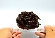 Guarnizione del cioccolato della ciambella fotografia stock