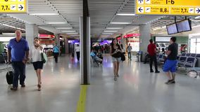 Guarulhos Airport, Sao Paulo. SAO PAULO, BRAZIL - OCTOBER 12, 2014: Travelers hurry at Guarulhos Airport in Sao Paulo. The airport served 36 million passengers stock video