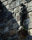 Guasti il ` la s Wark - statua sulla parete Immagini Stock